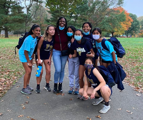 Aastha (top right) and her cross country teammates at a meet this fall