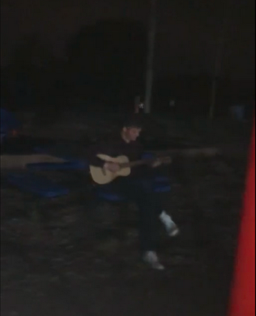 Ari plays his guitar
